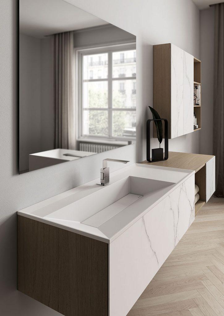 Arredo bagno Dogma by Aqua di Ideagroup in Rovere Naturale, gres effetto marmo statuario e lavabo in Cristalplant